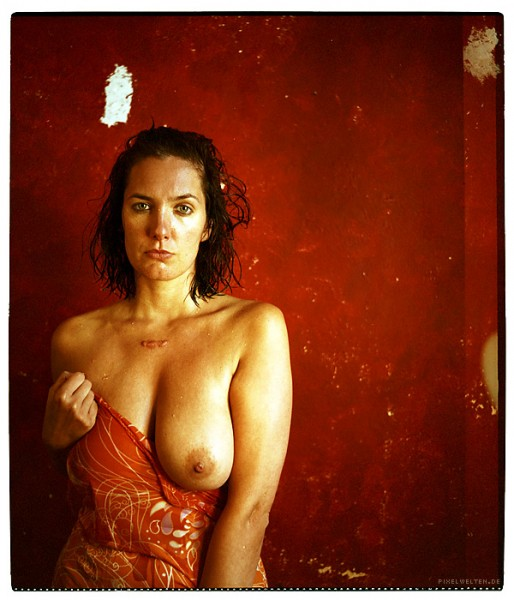 portrait of a writer with red wall nude