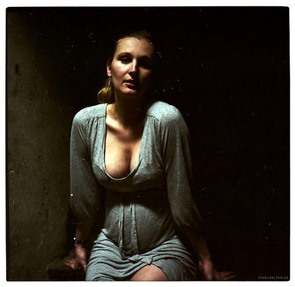portrait of a pregnant woman in attic