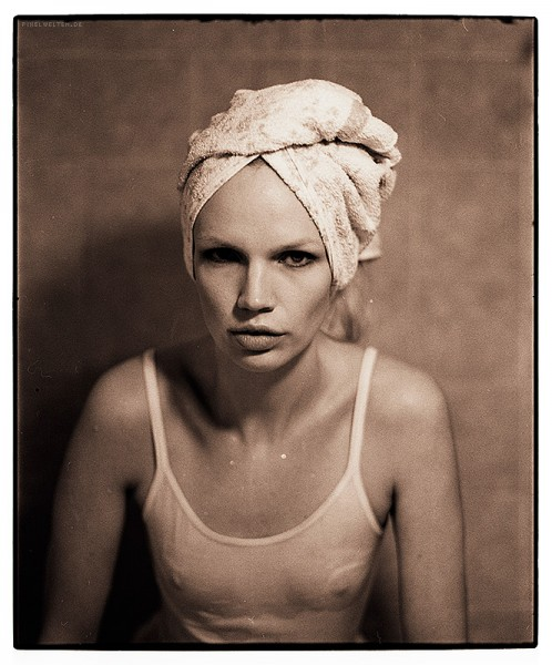portrait with towel in shower