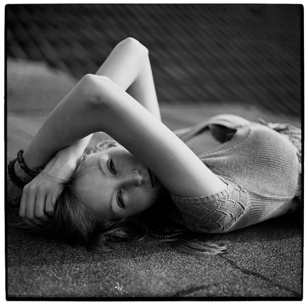 portrait of a blonde girl lying on roof (bnw)