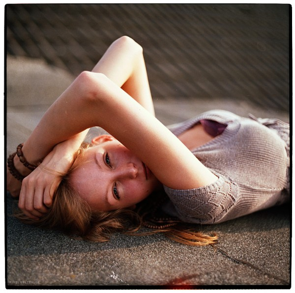 portrait of a blonde girl lying on roof (colour)